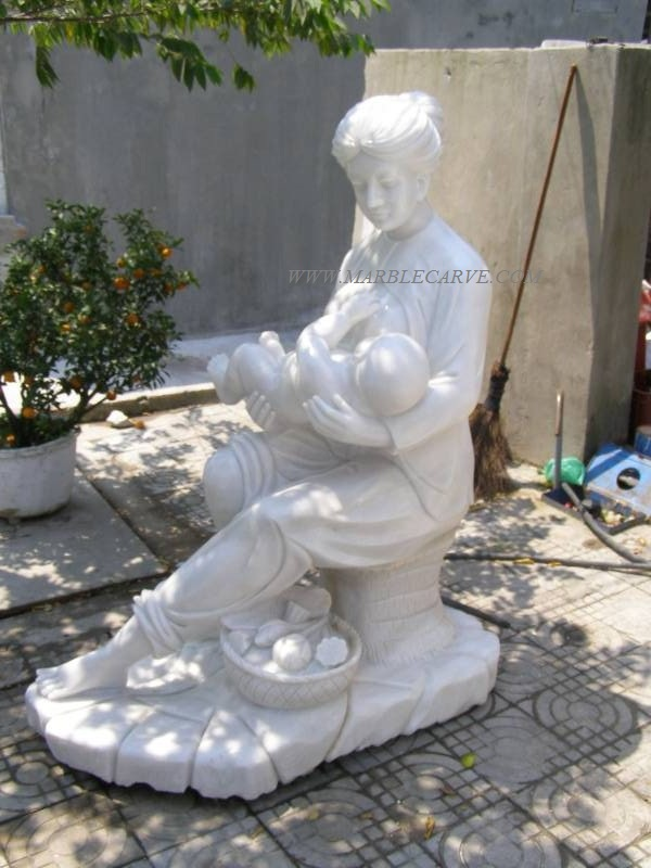 marble carving sculpture mother and baby statue photo image